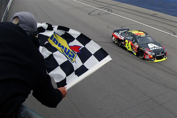 Jeff Gordon, driver of the #24 Axalta Chevrolet, takes the checkered flag to win the NASCAR Sprint Cup Series Pure Michigan 400 at Michigan International Speedway on August 17, 2014 in Brooklyn, Michigan. Photo by Brian Lawdermilk/NASCAR via Getty Images