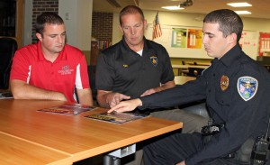 O-D school resource officers Kyle Hinds and Frank Lonigro discuss the School Guard app and program with marketing consultant Tim Guy.